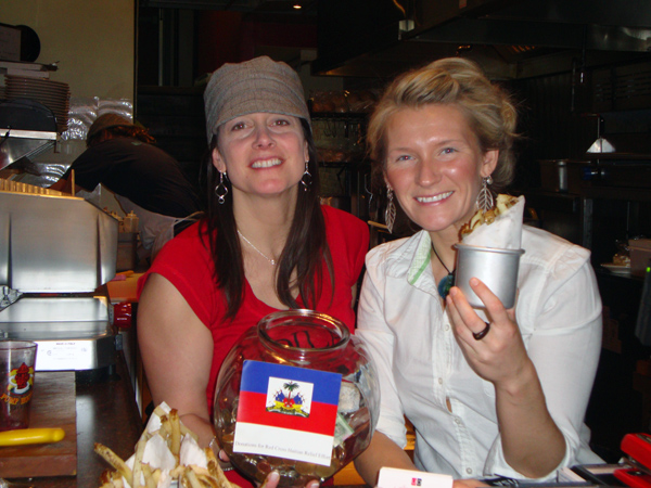 Lianne and Ashley of the Urban Deli holding donations for Haiti as well as ourfries!