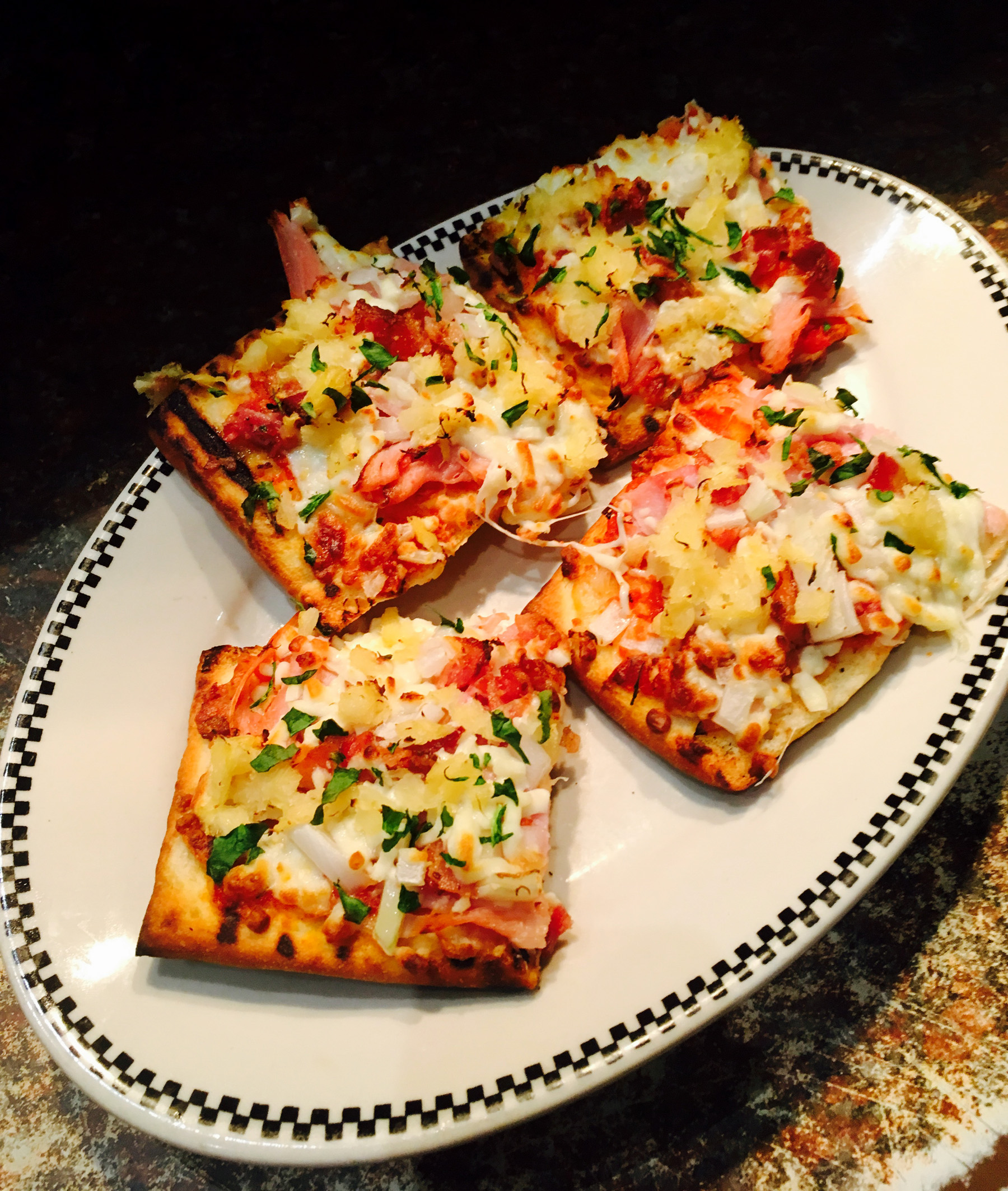 Our Grilled European Flat Bread Pizza also comes with your choice of soup or Caesar salad